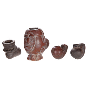 Four African Clay Smoking Pipes
