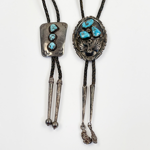 Collection of Two Navajo Turquoise, Silver Bolos